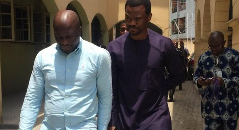 Lekki Gardens MD, Richard Nyong (right) and contractor arrive an Ebute-Meta Magistrate Court in handcuffs on Friday, March 11.