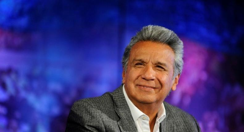 Ecuadorean President-elect Lenin Moreno receives the final official results of Sunday's runoff election at the House of Alianza Pais in Quito, on April 4, 2017