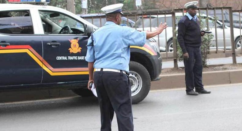 Police stopping vehicles along Thika Road