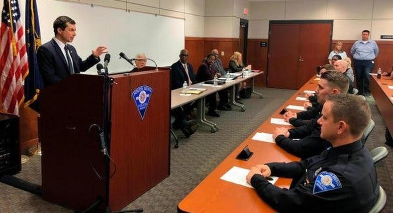Buttigieg tells police recruits of the burden of racial injustice