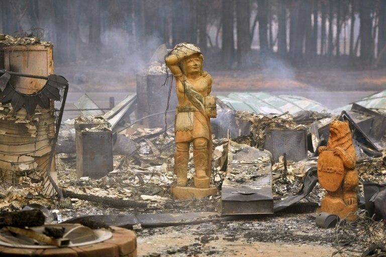 "Statues on the remains of a property burned in Paradise, California, by the ""Camp Fire"""