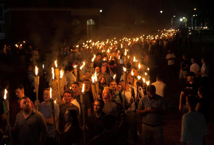 White nationalists carry torches on the grounds of the University of Virginia, on the eve of a plann