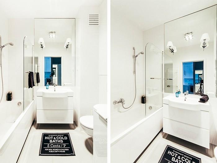 Klasyczne kinkiety nadają wnętrzu elegancji, a duże lustro powiększa przestrzeń.