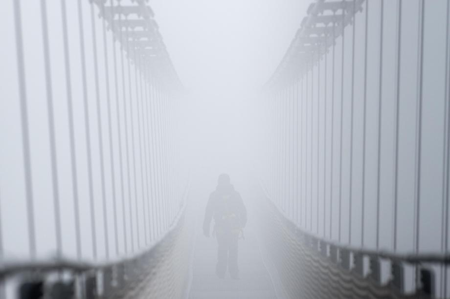 Heavy Fog on Pedestrian Suspension Bridge in Germany