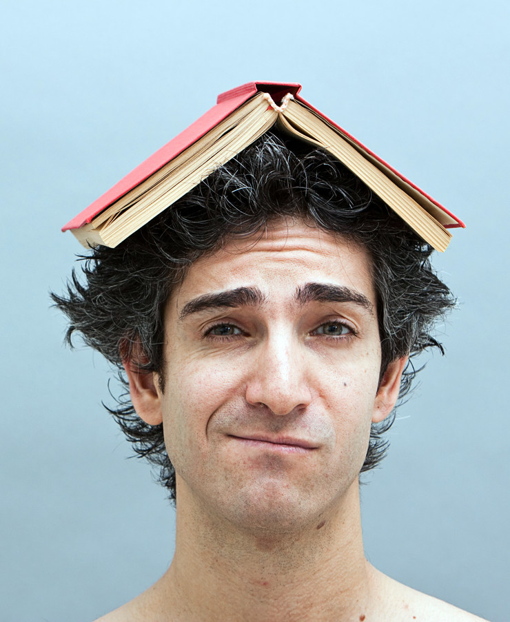 Stock-photo-bored-college-student-with-a-book-on-his-head-58183966