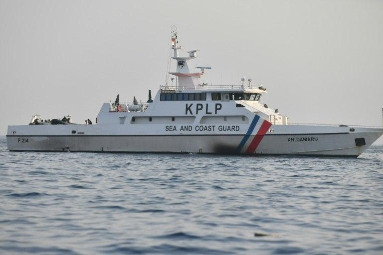 A coast guard ship is seen at the site where Lion Air flight JT 610 crashed into the sea in the waters north of Karawang, West Java province