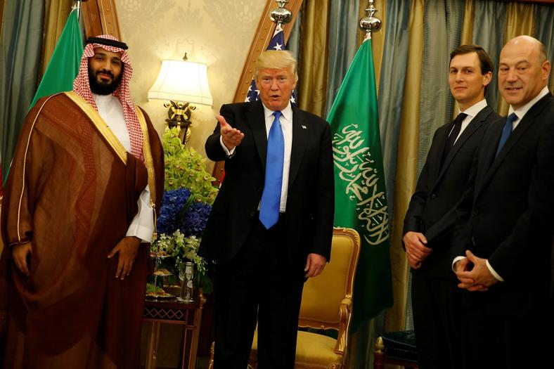 President Trump, flanked by White House senior advisor Jared Kushner (2nd R) and chief economic advisor Gary Cohn (R), delivers remarks to reporters after meeting with Saudi Arabia's Deputy Crown Prince Mohammed bin Salman at the Ritz Carlton Hotel in Riyadh on May 20, 2017.