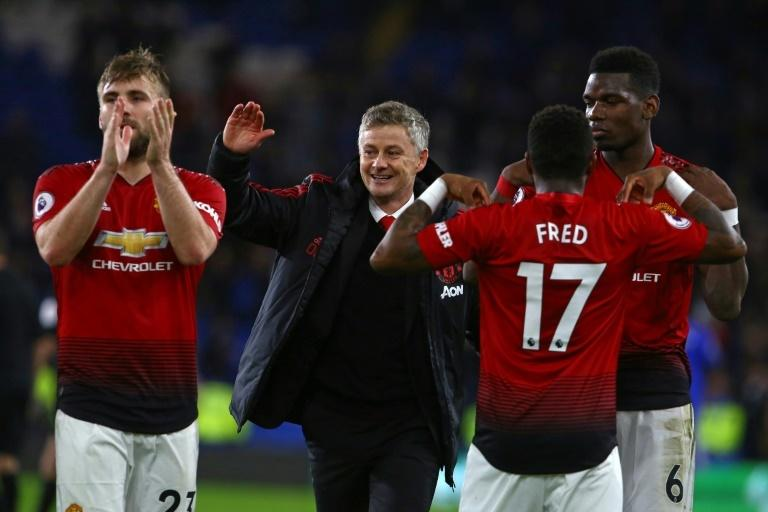 All smiles: Manchester United caretaker manager Ole Gunnar Solskjaer enjoyed a 5-1 win over Cardiff in his first match