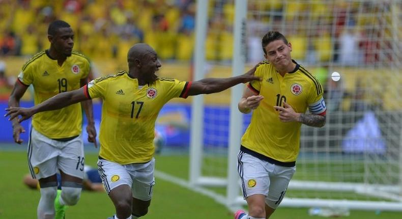 Colombia's midfielder James Rodriguez (R) celebrates next to teammate Pablo Armero after scoring a penalty against Bolivia during their 2018 FIFA World Cup qualifier football match in Barranquilla, on March 23, 2017