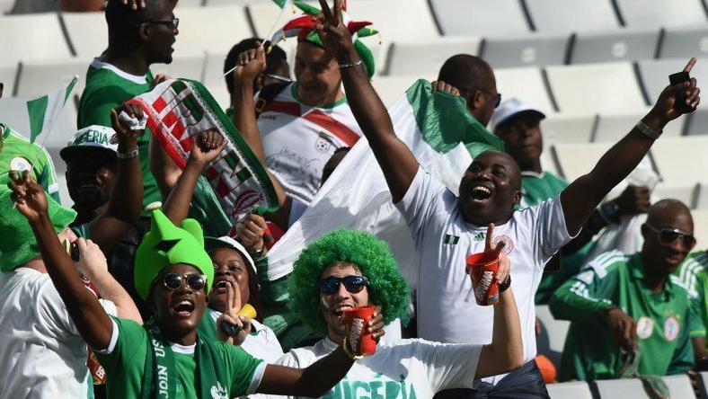 Nigeria's football supporters club jubilates at a stadium