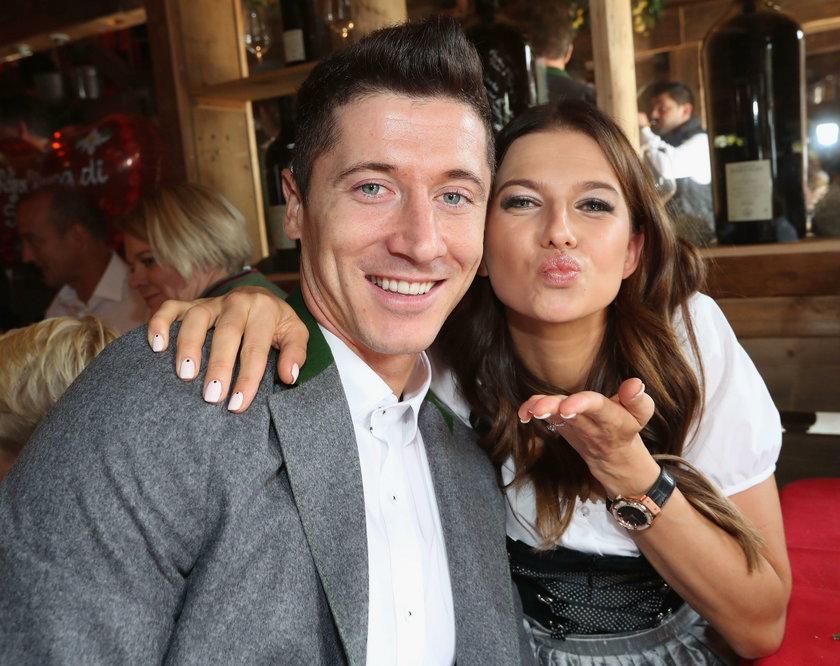 FC Bayern Munich's Lewandowski and his wife Anna pose during their visit at the Oktoberfest in Munic