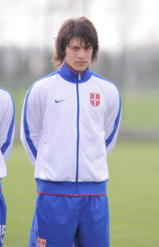 U juniorskoj reprezentaciji na utakmici protiv Gruzije 2014.