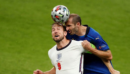 Italy defender Giorgio Chiellini (R) vies for the header with England's Harry Kane Creator: JOHN SIBLEY