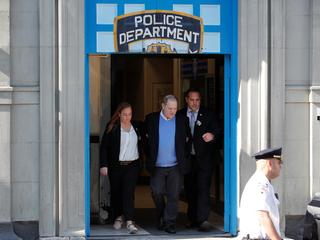 Film producer Harvey Weinstein leaves the 1st Precinct in Manhattan in New York