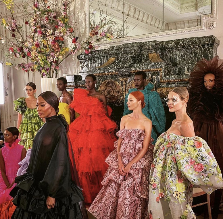 Ugandan model Ayak Veronica, 18, walks the runway during Valentino Couture Show alongside Naomi Campbell