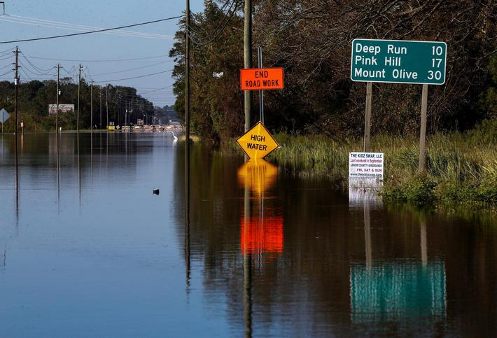 A road is blocked by flood waters in the aftermath of Hurricane Florence, now downgraded to a tropic