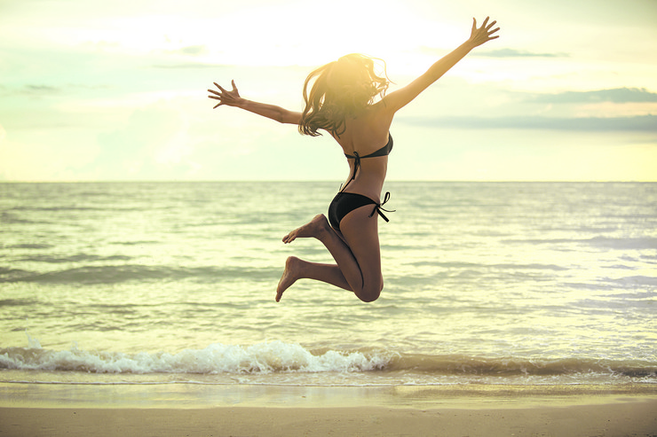 stock-photo-happy-asian-woman-jumping-on-the-beach-summer-vacation-concept-sunset-hight-key-622644401