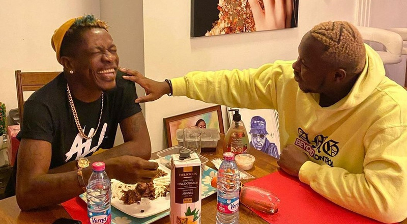Medikal visits Shatta Wale with his new Ranger Rover, gifts him iPhone 12 (WATCH)