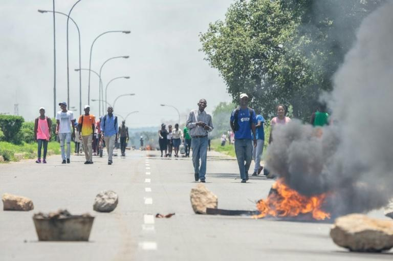 Protestors blocked roads with burning tyres and stones