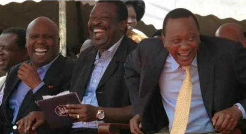 File image of Gideon Moi, Musalia Mudavadi and President Uhuru Kenyatta laughing