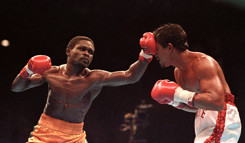 Azumah Nelson of Ghana lands a jab to the face of Puerto Rico's Juan LaPorte during their super-featherweight WBC title fight October 13, 1990 in Sydney. Nelson won a unanimous points decision, retaining his WBC title.