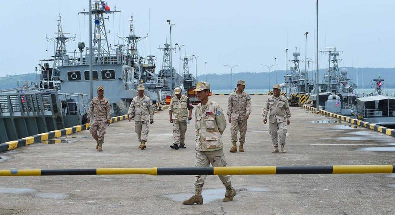 Cambodian navy personnel on a jetty at Ream naval base during a government-led media tour, July 26, 2019.