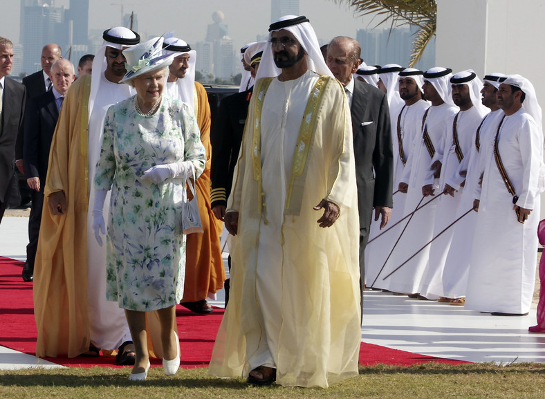 Britain's Queen Elizabeth walks with UAE's Vice President and Prime Minister Sheikh Mohammed bin Rashid Al Maktoum before the opening of the Sheikh Zayed National Museum in Abu Dhabi November 25, 2010.