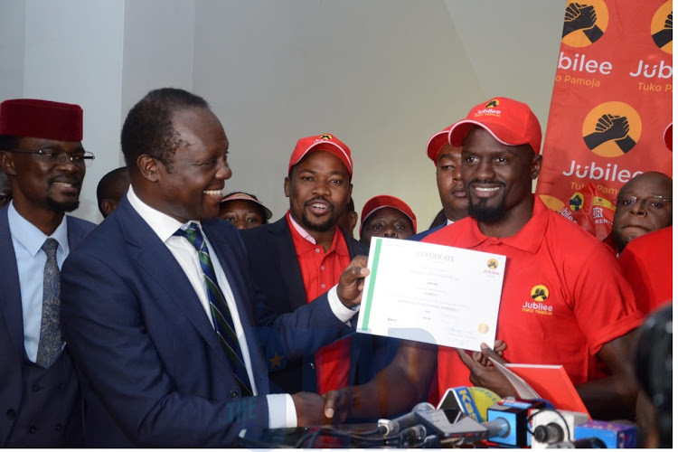 Jubilee's McDonald Mariga the party's nnation certificate from party Secretary General Raphael Tuju