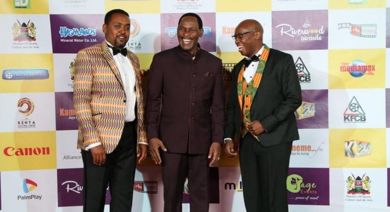 Host of the night Mwaniki Mageria, CEO of Kenya Films Classification Board Ezekiel Mutua and Kangethe Mungai of Riverwoods Ensemble at the red carpet.