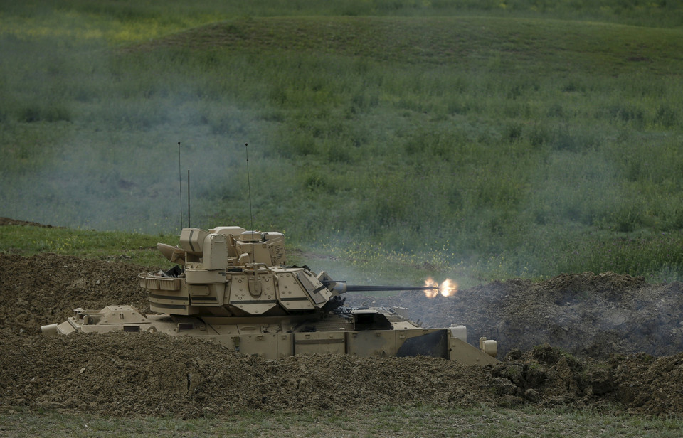 A U.S. Bradley infantry fighting vehicle fires during the joint U.S.-Georgian exercise Noble Partner 2015 at the Vaziani training area outside Tbilisi