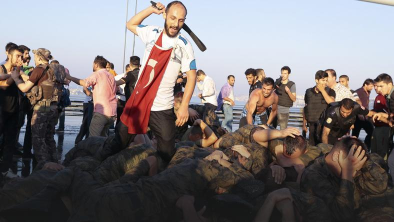 Surrendered Turkish soldiers who were involved in the coup are beaten by a civilian on Bosphorus bridge in Istanbul