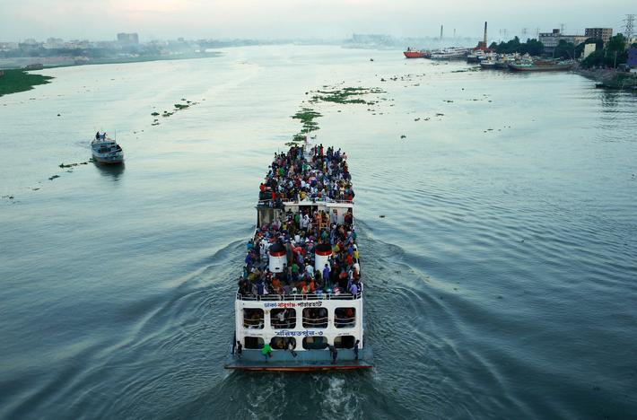 A ferry with passengers traveling home to celebrate Eid al-Fitr festival leaves Dhaka