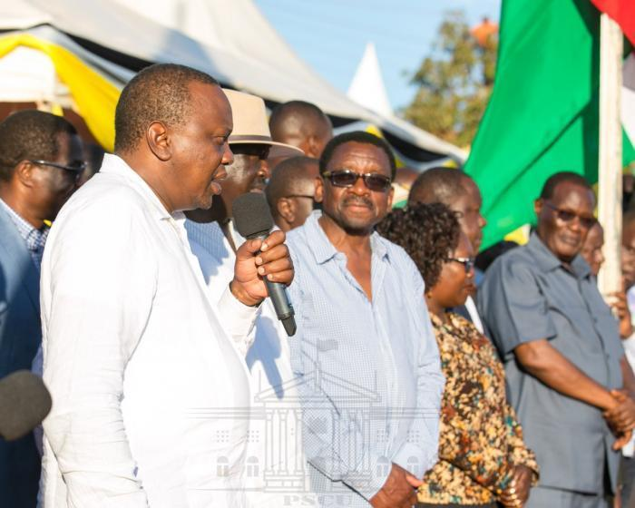 James Orengo watches as President Kenyatta addresses the public during his recent visit to Kisumu