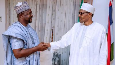 President Buhari swears in veteran journalist Sunday Dare as sports minister
