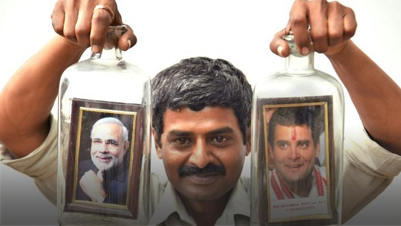 Message in a bottle ... artist Basavaraj poses with a creation showing Indian Prime Minister Narendra Modi and his election rival Rahul Gandhi