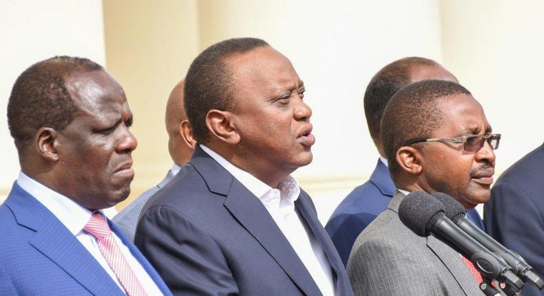 President Uhuru Kenyatta with Council of Governors chair Wycliffe Oparanya and his deputy Mwangi Wa Iria during a past presser at State House (PSCU)