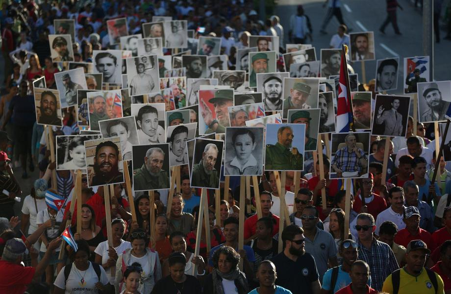 People carry images of late Cuban President Fidel Castro during a march to Santa Ifigenia Cemetery t