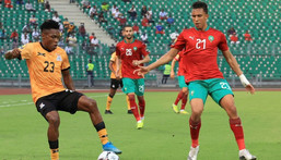 Raja Casablanca star Soufiane Rahimi (R) playing for Morocco against Zambia in the African Nations Championship in Cameroon this year. Creator: Daniel BELOUMOU OLOMO
