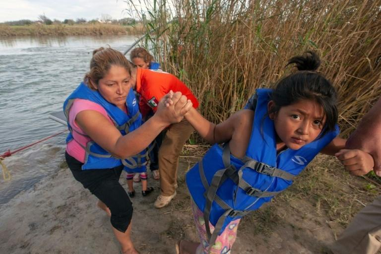 Central American migrants trying to reach the United States across the Rio Bravo river are rescued by a Mexican group dedicated to migrant rights