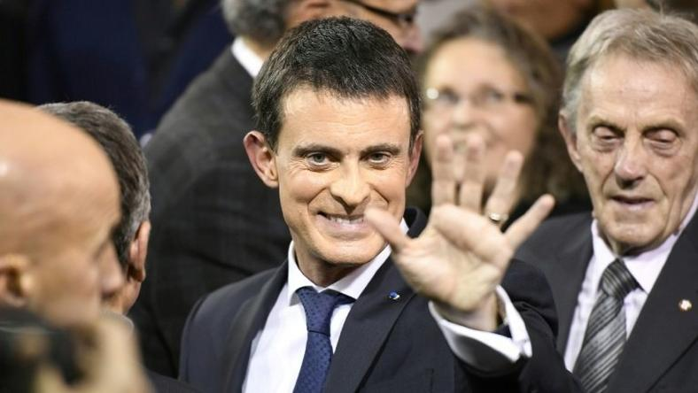 French Prime Minister Manuel Valls greets supporters after announcing his bid to become the Socialist presidential candidate in the 2017 presidential elections, at the town hall of Evry
