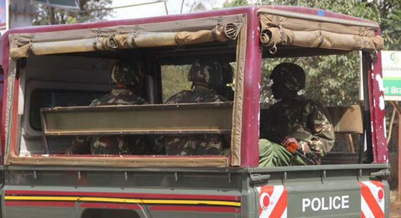 File image of police officers on patrol. Kelvin Adeshina Akinjiola was arrested and deported on Saturday