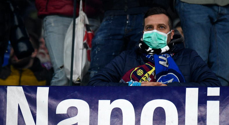 NAPLES, CAMPANIA, ITALY - 2020/02/25: Fan wearing masks for fear of coronavirus infection (COVID-19) at the San Paolo Stadium in Naples, during the football match UEFA Champions League, SSC Napoli vs FC Barcelona. (Photo by Salvatore Laporta/KONTROLAB/LightRocket via Getty Images)
