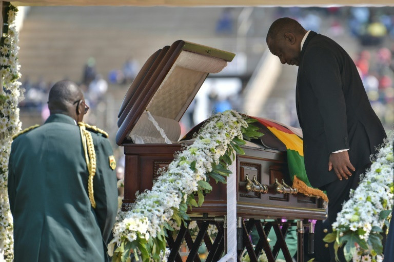 South Africa's President Cyril Ramaphosa paying his last respects.