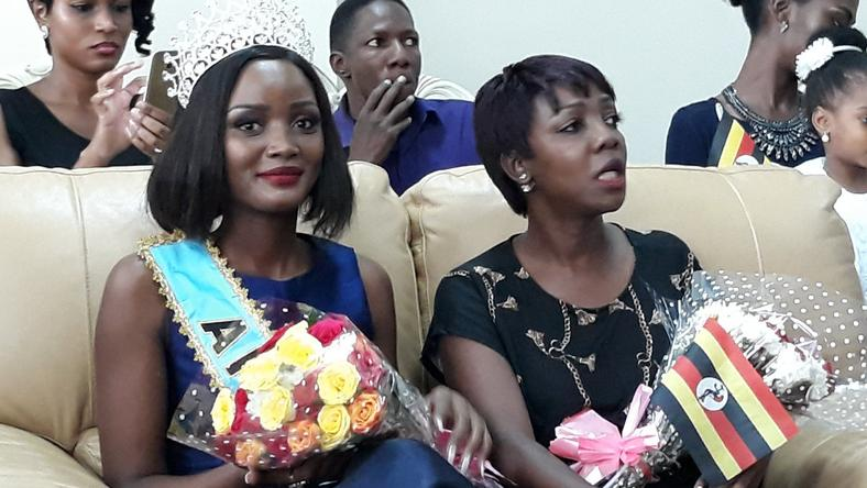 Miss Uganda Abenakyo sitting next toMiss Uganda Foundation CEO Brenda Nanyonjo shortly after arriving in Uganda