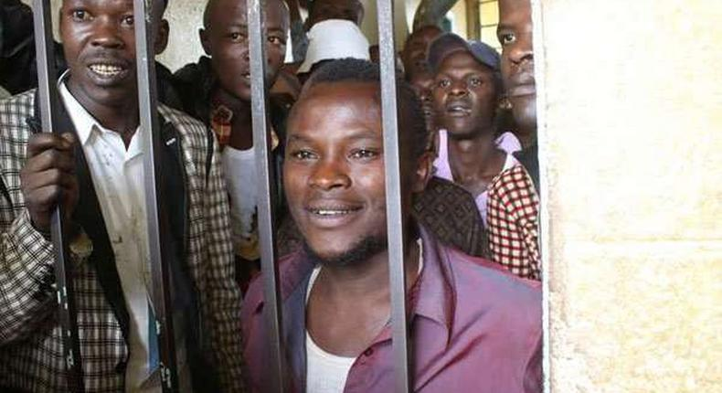 Julius Mwithalii (right) at the Maua Law Courts cells after appearing before Senior Resident Magistrate Antony Munene where he was charged with attempted suicide.