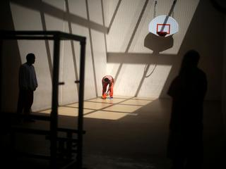 FILE PHOTO: Detainees exercise in a recreation area at the Adelanto immigration detention center, wh