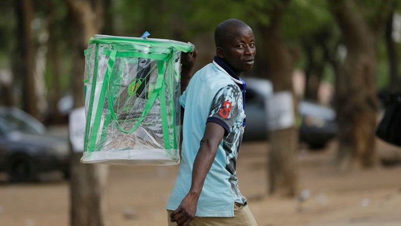 An election official walks away with an empty ballot box (image is not of the officer in this story but is used for illustrative purpose only)