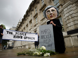 Protestor wearing a Theresa May mask is seen the day after Britain's election in London