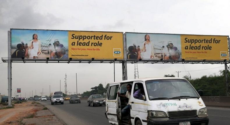 A billboard advertising MTN telecommunication company is seen along a road in Lagos November 16, 2015. (REUTERS/Akintunde Akinleye)