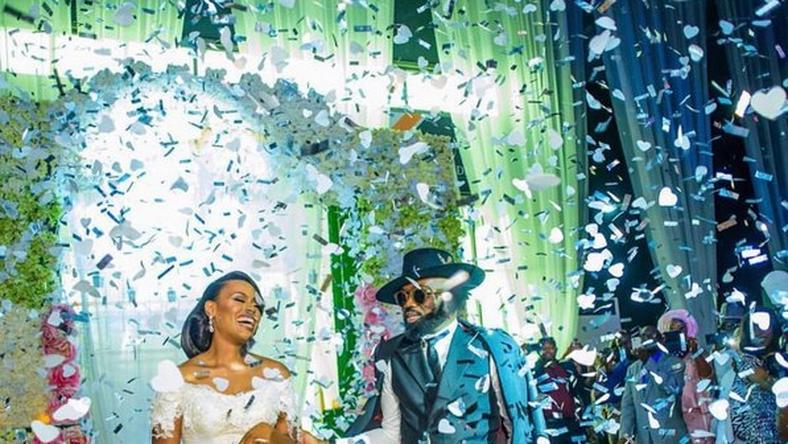 Noble Igwe and Chioma Igwe at their wedding